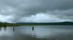 Two Fishermen Fishing in the middle of a lake, Sweden. Tripod wide angle - stock footage