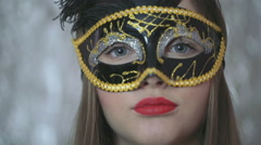 Beautiful woman in carnival mask looking to the camera, steadycam shot Stock Footage