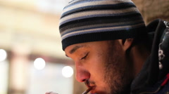 Man lighting up cigarette, smoking tobacco in public place, unhealthy habit Stock Footage