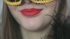 Happy woman wearing red lipstick and carnival mask, steadycam shot Stock Footage