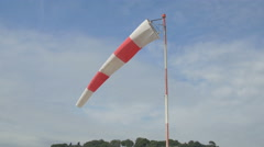 A red and white windsock on the beach in Nice - stock footage
