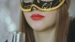 Woman wearing carnival mask and drinking schampagne, steadycam shot Stock Footage