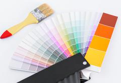 Color chart guide for renovation with brush on white background Stock Photos