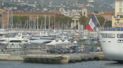 Sailboats moored and cars parked in the port of Nice - stock footage