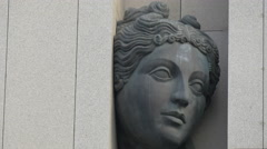 Close up of a bronze statue of a goddess encased in granite at AC Hotel, Nice Stock Footage