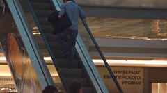 Man Riding on the Escalator at the Mall Stock Footage