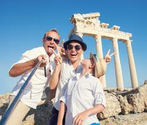 Funny family take a selfie photo on Apollo Temple colonnade view in Side, Tur Stock Photos