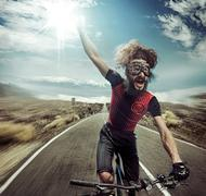 Portrait of a funny yelling cyclist Stock Photos