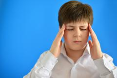 Portrait of teenage boy with a headache Stock Photos