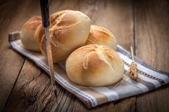Several kaiser rolls. - stock photo