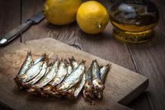 Tasty smoked sprats. Stock Photos