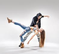 Acrobat pose of a two talented dancers Stock Photos