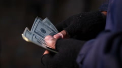 Hands of bank robber or drug dealer counting money, income from illegal acts - stock footage