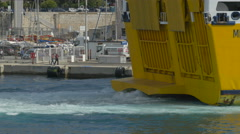 Foamy water behind a ferry at the port of Nice Stock Footage