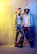 Portrait of two talented hip-hop dancers on a concrete background - stock photo