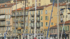 The shuttered facade of buildings and sailboat masts in Port Lympia, Nice Stock Footage