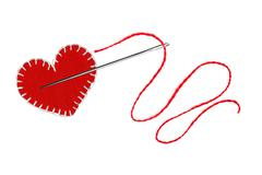 Red heart, thread and needle isolated on white - stock photo