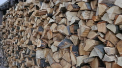Firewood prepared for winter stockpiled by wall as a decoration for beauty Stock Footage