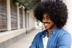 Smiling african american man with afro - stock photo