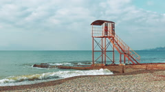 Empty lifeguard tower on the beach of the sea in the early morning Stock Footage