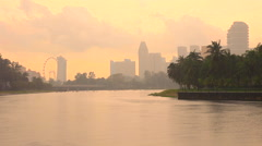 View to Singapore downtown from the Kallang river park during sunset Stock Footage