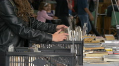 Woman looking in a box with books in London Stock Footage