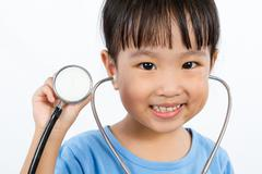 Asian Little Chinese Girl Playing Doctor with a Stethoscope Stock Photos