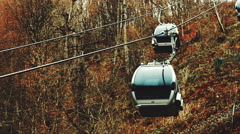 Close-up view of cableway cabins lifts up and goes down - stock footage