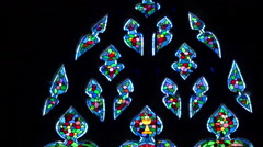 Colorfull religious stained glass window in a church - panoramic up Stock Footage