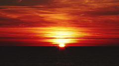 Beautiful sunset over the sea with red clouds Stock Footage