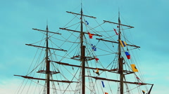 Three-masted frigate ship with colorful flags - stock footage
