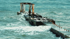 Old concrete structure in the sea breaking waves during a heavy storm Stock Footage