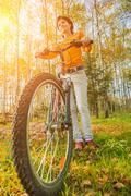 Stock Photo of Beautiful girl riding bicycle