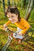 Beautiful girl riding bicycle - stock photo