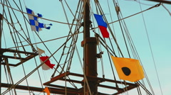 Colorful flags fluttering in the wind on the rigging - stock footage