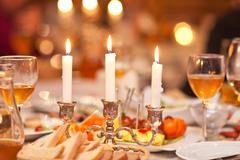 The burning candles in a candlestick on a festive table - stock photo