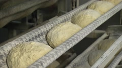 Automated production of bread. The bread dough is formed by baking Stock Footage
