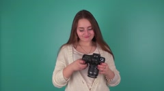 She enjoys buying the camera. It makes the first photo Stock Footage