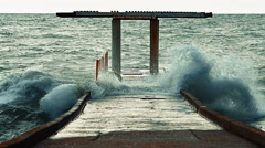A powerful stream of water floods concrete breakwater during a heavy storm Stock Footage