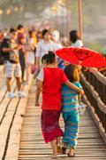 Thai llittle girl holding umbrella Stock Photos
