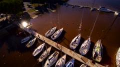 Aerial shot of the yachts and boats on dock Stock Footage