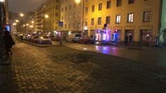 People walking on Vaasankatu on the Saturday evening - stock footage
