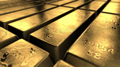 Gold bars stacked up in perfect rows. Concept of banking and ultimate wealth. Stock Footage
