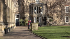 Woman walk historic Bury St Edmunds Cathedral courtyard England 4K Stock Footage