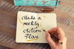 Handwritten text Make a Weekly Action Plan - stock photo