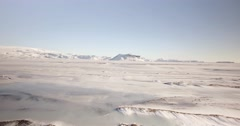 Areal adventure shot, fly over person in large wide open snow covered landscape Stock Footage