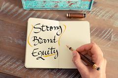 Handwritten text Strong Brand Equity - stock photo