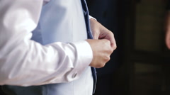 groom wears a vest. Close up of hand the groom wears a vest. - stock footage