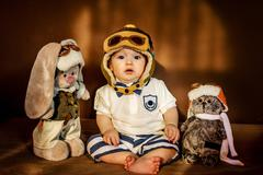 Young aviator and his friends. - stock photo