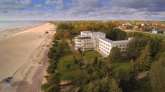 The big white building in front of the beach Stock Footage